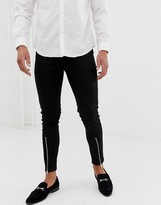 Asos Design DESIGN skinny jeans with zipped hem detail in black