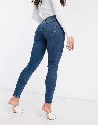 Asos DESIGN Whitby low waist skinny Jeans in lightwash blue