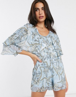 Liquorish playsuit with frill sleeves in floral print