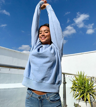 ASOS DESIGN Petite oversized washed sweatshirt in cornflower blue