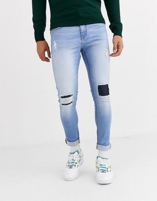 Criminal Damage skinny jeans in lightwash blue with distressing
