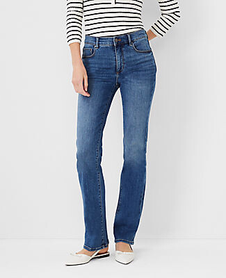 Ann Taylor Petite Curvy Sculpting Pocket Slim Boot Cut Jeans in Mid Stone Wash