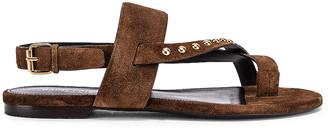 Saint Laurent Gia Stud Sandals in Land | FWRD