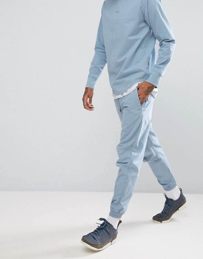 MHI Woven Joggers In Blue With Small Logo