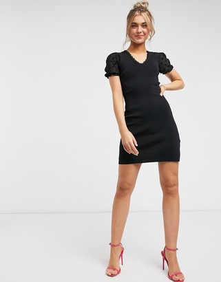 Morgan knitted bodycon dress with contrast dotty tulle mesh back in black