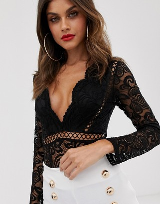 Love Triangle plunge front scallop edge body with tassel detail and lace insert in black