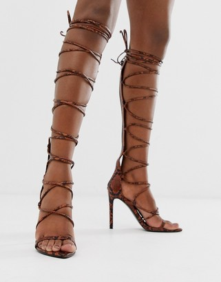 Asos Design DESIGN Harsh knee high gladiator heeled sandals in orange snake