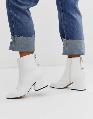 Head Over Heels By Dune Oka white curved mid heeled ankle boots