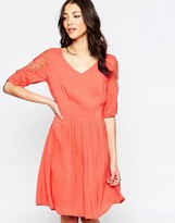 Lavand Skater Dress With Lace Sleeves And Lace Back Detail