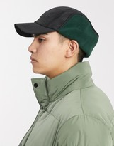 Asos Design DESIGN baseball cap in black and green with ear flaps