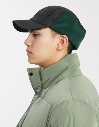 Asos DESIGN baseball cap in black and green with ear flaps