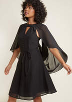 MCD1088 The neckline cutout and delicate buttons of this black dress from our ModCloth namesake label make this look a delight, but those are only the beginning. This vintage-inspired frock's gorgeous cape - which can be worn draped over the shoulders or tossed b