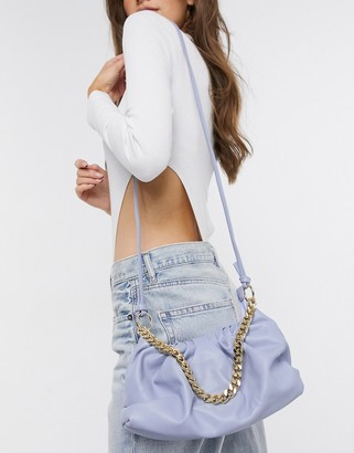 Truffle Collection slouchy pillow bag with chunky chain in light blue