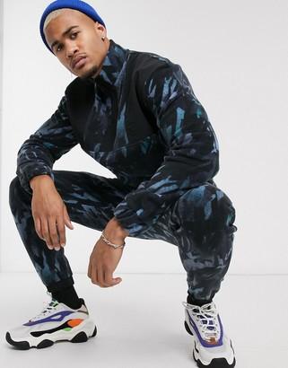 Asos Design DESIGN two-piece slim sweatpants with camo fleece and nylon panels