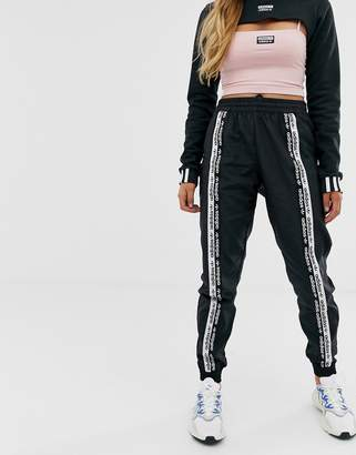 adidas RYV taping track pants in black