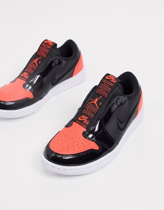 Jordan Nike Air 1 retro low red and black slip on sneakers
