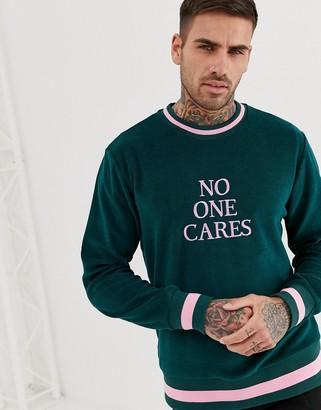 Asos Design DESIGN sweatshirt with slogan text print in towelling-Green