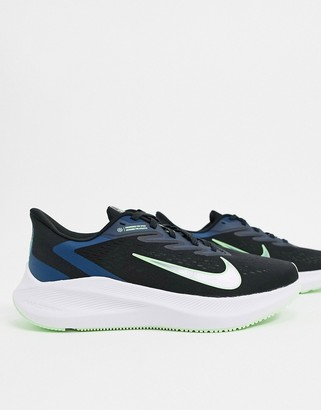 Nike Running Winflo trainers in black and blue