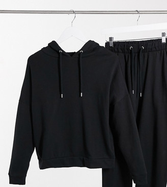 ASOS DESIGN Petite organic cotton tracksuit hoodie and slim trackies with tie in black