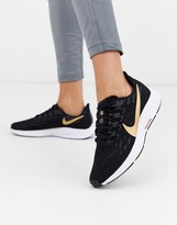 Nike Running pegagus 36 sneakers in black with gold swoosh