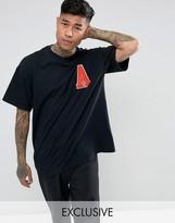Reclaimed Vintage Inspired Oversized Varsity T-Shirt In Black