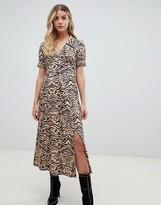 Asos Design DESIGN animal print midi tea dress in rib