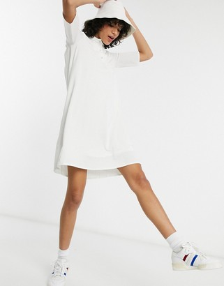 Lacoste pleated dress in white