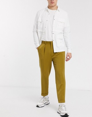 ASOS DESIGN smart tapered trousers in mustard with turn up