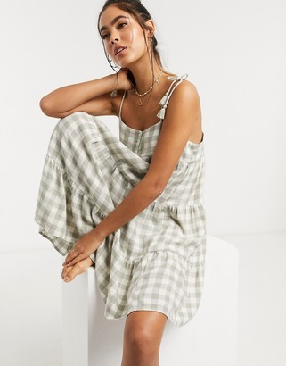 Accessorize mini beach dress in green and white gingham