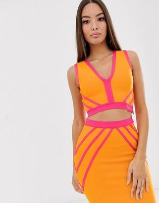 The Girlcode bandage mesh crop top in orange and pink