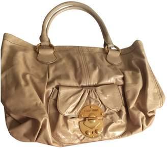 Miu Miu Beige Patent leather Handbags
