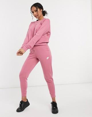 Nike essentials slim trackies in dusty pink