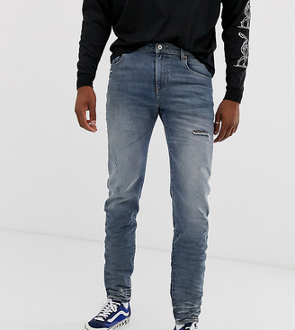 ASOS DESIGN Tall 12.5oz tapered jeans in mid wash blue wih abrasions