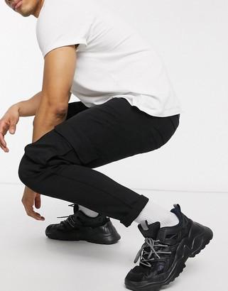 Bershka super skinny cargo trousers in black
