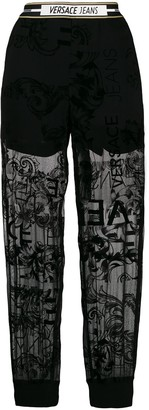 Versace lace panelled track trousers