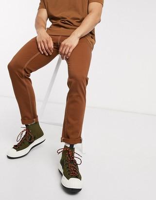 Asos DESIGN stretch slim jeans in rust
