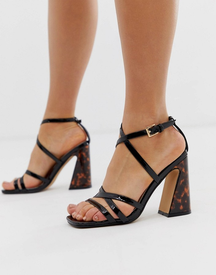 By Dune Meredith black patent strappy heeled sandals with tortoise effect heel detail