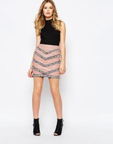 Goldie Empire Faux Leather Skirt With Tassel Trims