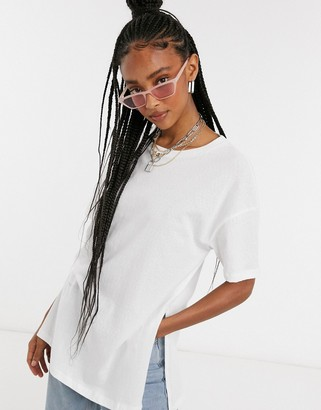 ASOS DESIGN textured longline t-shirt with side splits in white