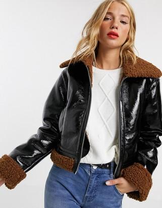 Asos Design DESIGN vinyl faux shearling biker jacket in black