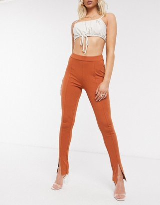 NA-KD skinny trousers with split front in rust