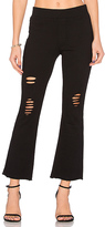 Pam & Gela Cropped Flare Pant in Black. - size XS (also in )