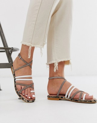 ASOS Buttercup leather strappy flat sandals in white and grey