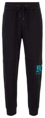 BOSS Drawstring loungewear trousers in knitted pique with textured logo