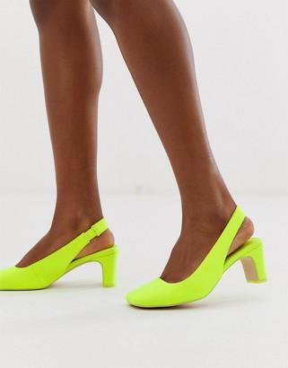 ASOS DESIGN Serpent slingback mid heels in neon yellow