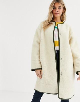 Asos Design DESIGN collarless borg coat with seam detail in cream