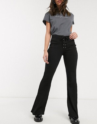 Bershka ribbed flared pants with tie up detail in black