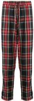 Andrea Crews logo check drawstring trousers