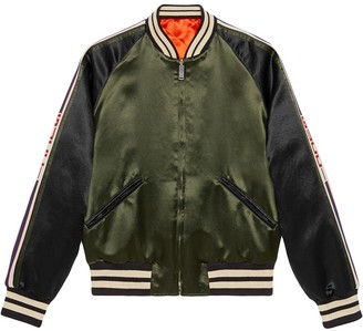 Gucci Reversible bomber jacket with printed sleeves