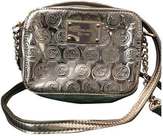 Michael Kors Metallic Patent leather Handbags